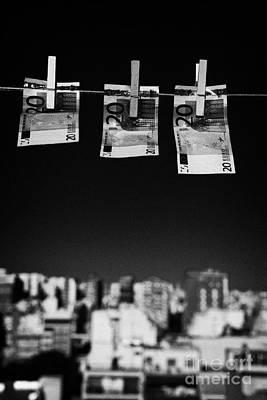 Three Twenty Euro Banknotes Hanging On A Washing Line With Blue Sky Over City Skyline Art Print by Joe Fox