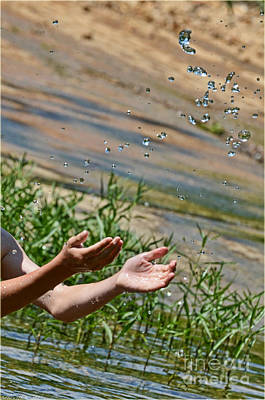 Photograph - Throwing Water II by Debbie Portwood