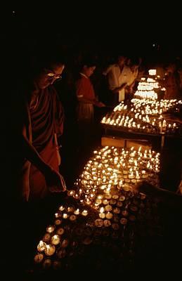 Tibetan Buddhist Monks Light Yak Butter Art Print by Gordon Wiltsie
