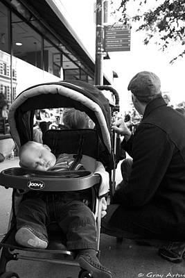 Photograph - Tired Child Sleeping In Baby Stroller With Dad by Gray  Artus