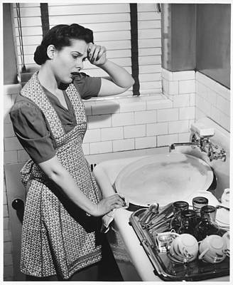 Tired Woman At Kitchen Sink, (b&w), Elevated View Art Print