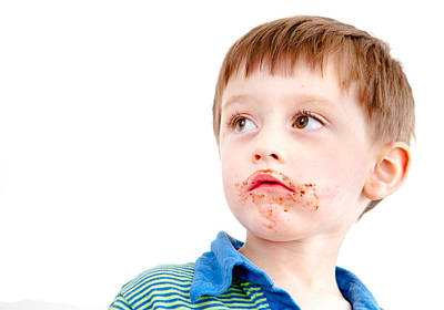 Worried Photograph - Toddler Eating Chocolate by Tom Gowanlock