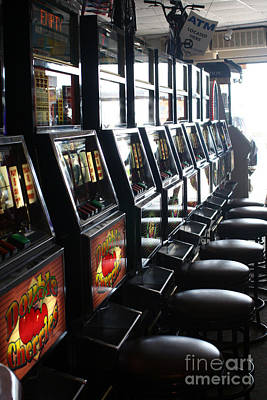 Photograph - Token Slot Machines by Susan Stevenson