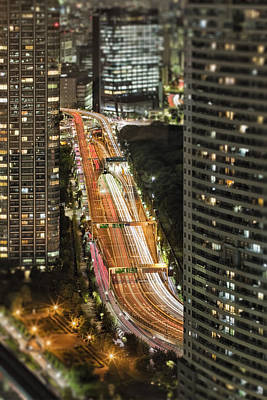 Tokyo Freeway And Skyscrapers At Night Art Print by Bryan Mullennix