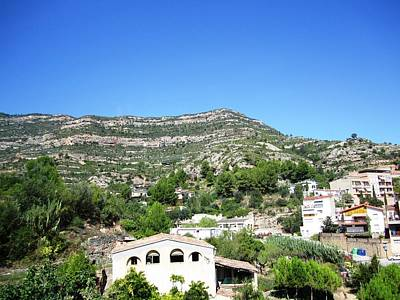Photograph - Towards Montserrat Monastery Panoramic Mountain View Homes Blue Sky Near Barcelona Spain by John Shiron