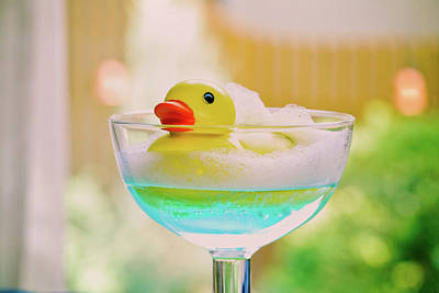 Rubber Duck Photograph - Toy Duck Swimming In A Glass Of Blue Water by Margarita Komine