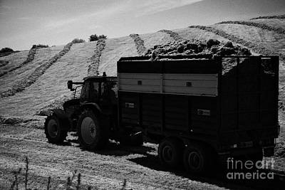 Tractos Towing Trailer Full Of Grass For Silage Production Irish Field Ireland Art Print by Joe Fox