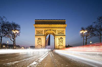 Paris Photograph - Traffic In Front Of Arc De Triomphe At Dusk by Jorg Greuel