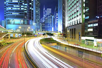 Hong Kong Photograph - Traffic Through Downtown by Leung Cho Pan