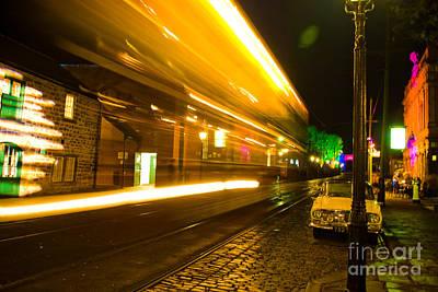 Photograph - Tram Light Trail 2.0 by Yhun Suarez