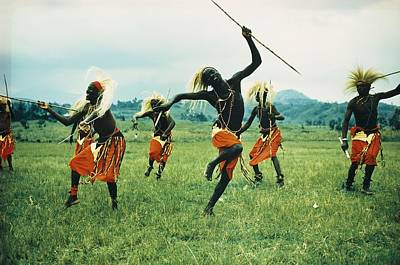 Tutsi Men Recall Days Of Glory In An Art Print by George F. Mobley