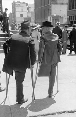 Vachon Photograph - Two Amputees On Crutches Outside Church by Everett