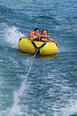 Inflatable Photograph - Two Children On Inflatable Ring by Sami Sarkis