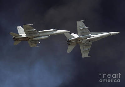 Photograph - Two Fa-18c Hornets Perform A Carrier by Stocktrek Images