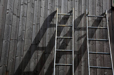 Two Ladders Leaning Against A Wooden Wall Art Print