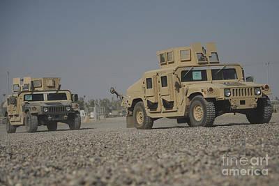 Two M1114 Humvee Vehicles At Camp Taji Art Print by Stocktrek Images