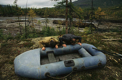 Inflatable Rafts Photograph - Two Men Use Lung Power To Top by Randy Olson