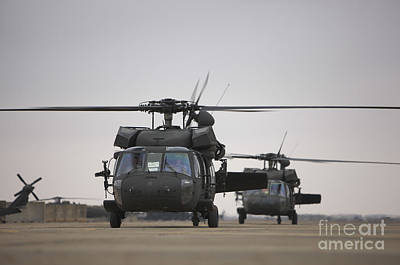 Two Uh-60 Black Hawks Taxi Print by Terry Moore