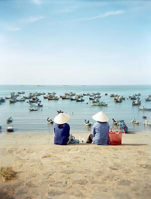 Two Vietnamese Merchant Ladies Taking Art Print by Justin Guariglia