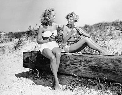 Two Women Drinking Soda On Beach Art Print by George Marks