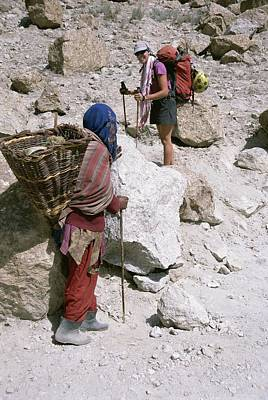 Transportation Of Goods Photograph - Two Women From Different Cultures by Jimmy Chin