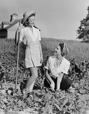 Two Women Gardening In Field Art Print by George Marks