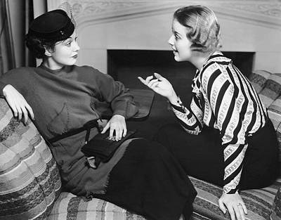 Two Women In Casual Conversation Art Print by George Marks
