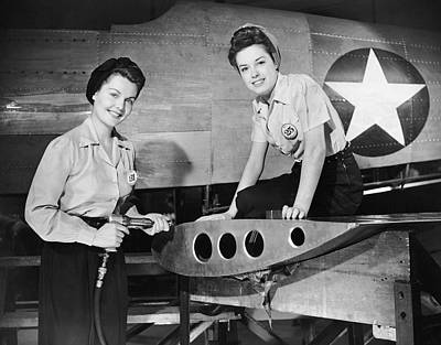 Two Women Working On Airplane Art Print by George Marks