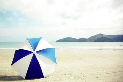 Single Object Photograph - Umbrella On Sand by Grace Oda