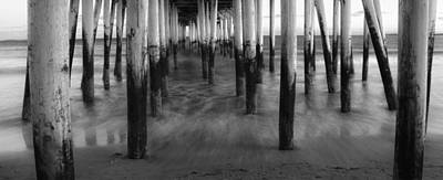 Under The Oob Pier Art Print by Guy Whiteley