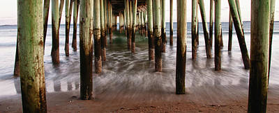 Under The Pier Art Print by Guy Whiteley