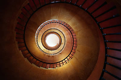 Underneath A Stone Spiral Staircase Looking Up Print by Tracy Packer Photography