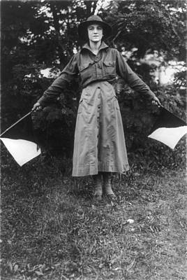Uniformed Woman Using Signal Flags, Wig Art Print by Everett