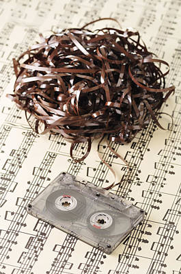 Old Sheet Music Photograph - Unravelled Cassette Tape On Sheet Music by Jean-Christophe Riou