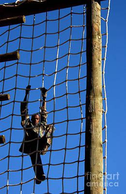 U.s. Air Force Airman Climbing Net Art Print by Stocktrek Images