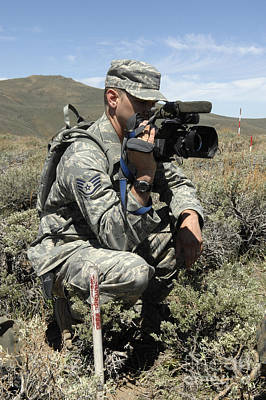 Videographer Photograph - U.s. Air Force Sergeant Shoots Video by Stocktrek Images