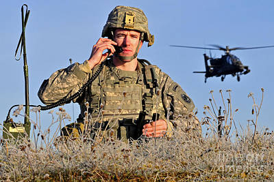 U.s. Army Captain Directs An Ah-64 Art Print by Stocktrek Images