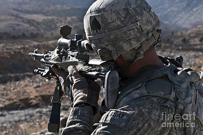 Photograph - U.s. Army Sniper Scans A Village by Stocktrek Images