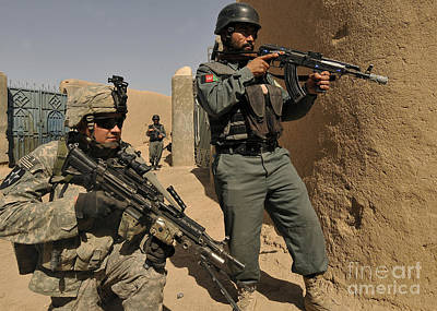 Afghan National Army Photograph - U.s. Army Soldier And An Afghan by Stocktrek Images