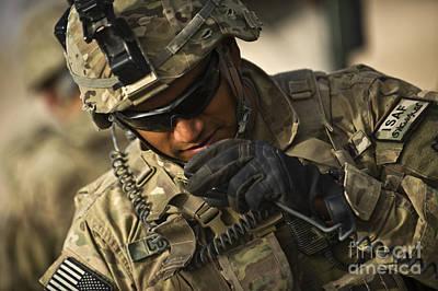 U.s. Army Soldier Communicates Art Print by Stocktrek Images