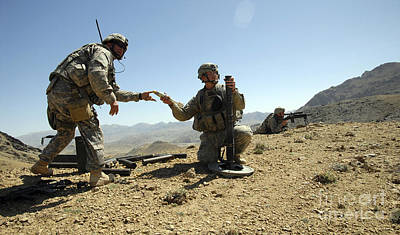 Photograph - U.s. Army Soldier Hands A 60 Mm Mortar by Stocktrek Images