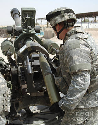 U.s. Army Soldier Loads A 105mm Art Print by Stocktrek Images