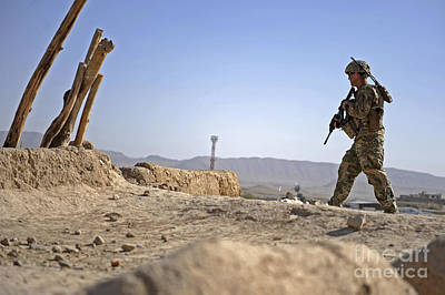 Qalat Photograph - U.s. Army Soldier On A Foot Patrol by Stocktrek Images