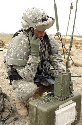U.s. Army Soldier Performs A Radio Art Print by Stocktrek Images