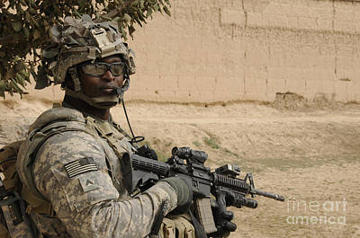 U.s. Army Soldier Scans His Area While Art Print by Stocktrek Images