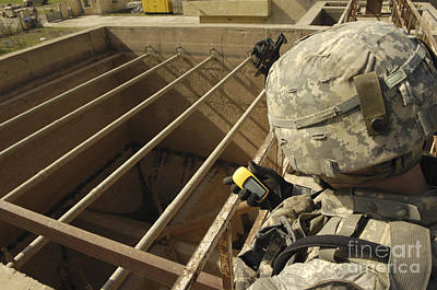 Photograph - U.s. Army Soldier Takes A Gps Grid by Stocktrek Images
