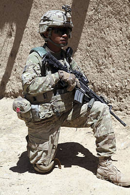 Logar Photograph - U.s. Army Soldier Takes A Knee While by Stocktrek Images