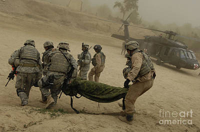 Minotaur Photograph - U.s. Army Soldiers Medically Evacuate by Stocktrek Images