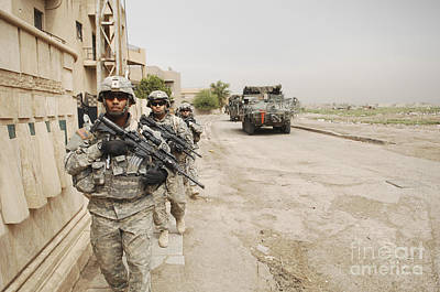 U.s. Army Soldiers Moving To Their Next Art Print by Stocktrek Images