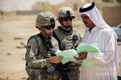 U.s. Army Soldiers Talking With A Town Art Print by Stocktrek Images